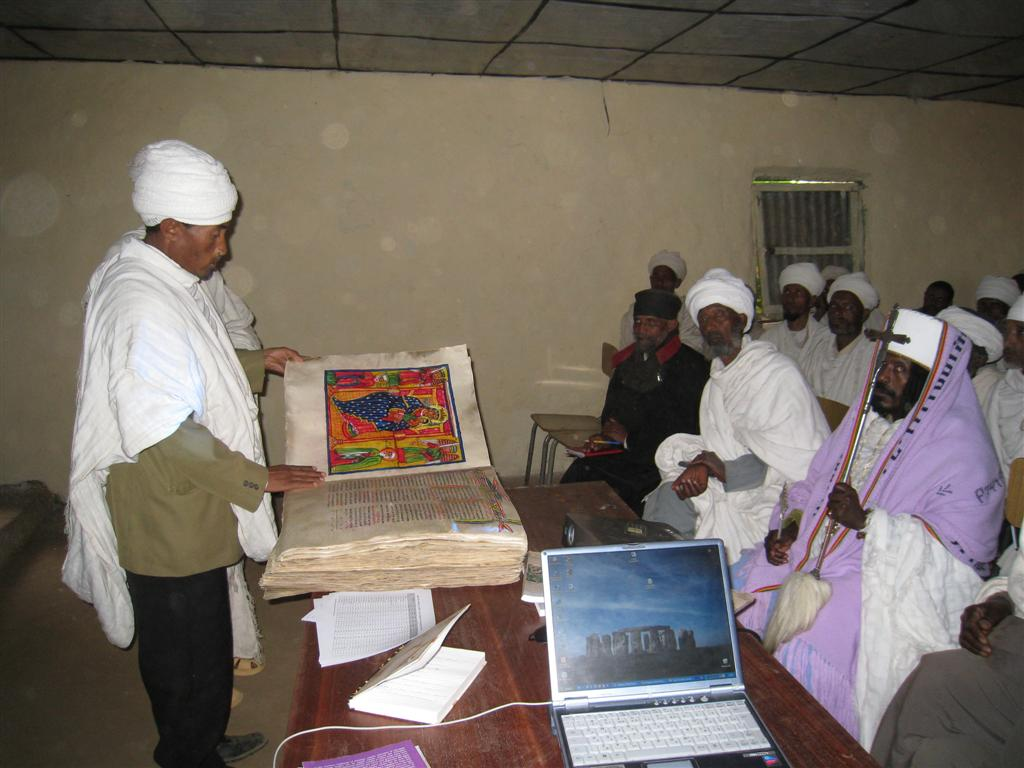 126._Priests_share_some_of_their_sacred_books.jpg