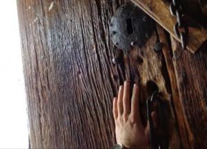 A hewn Juniper doorway to a Lalibela church.