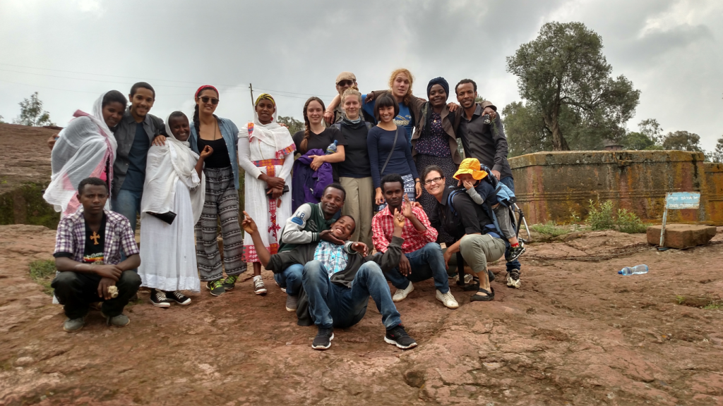 Summer 2015 REU students and Ethiopian research partners in front of Saint George's church in Lalibela.