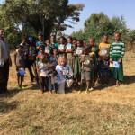 Dr. Meg Lowman giving out Beza books to local Ethiopian children.