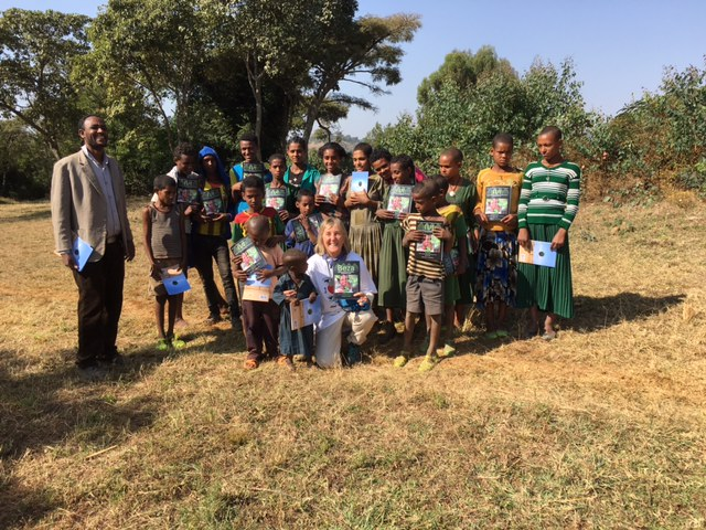 Dr. Meg Lowman giving out Beza books to local Ethiopian children.