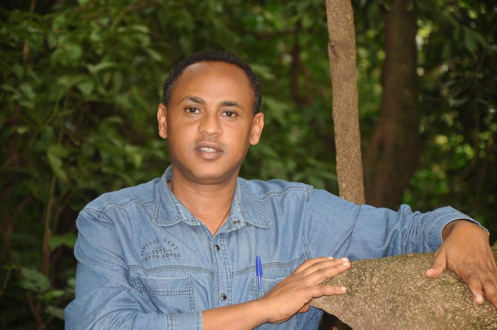 Dr. Alemayehu Wassie poses for a photo in one of his beloved church forests