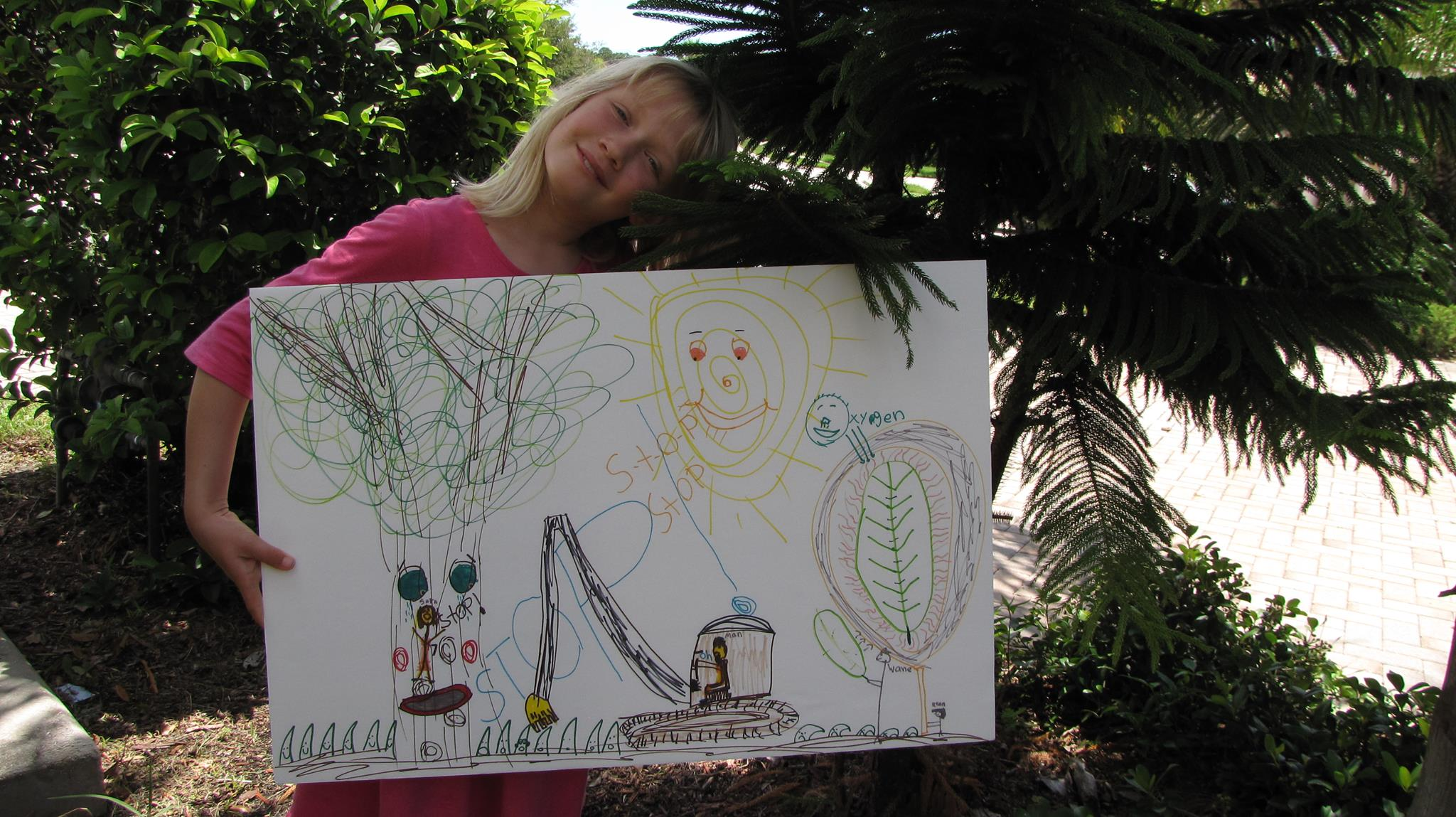 Sara's Poster Description: I am climbing a tree in the park and telling a man in a excavator to stop taking down trees. The sun is also telling him to stop. A close view of a leaf (right side) shows how the oxygen we need is being produced.